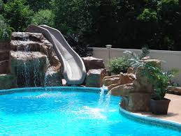 In ground pools with waterfalls Back Yard Exterior Swimming Pool With High Slides And Stairs Combined Design Ideas For Small Apartments Paulshi Swimming Pools Mi E2 80 93 Legendary Escapes Custom Michigan Pool By