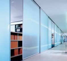 office corridor door glass. The Picture Depicts A Large Office Corridor; There Are Smaller Offices Running Off It Which Corridor Door Glass