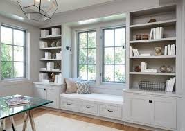 built in home office. light gray office built in shelves and cabinets home n