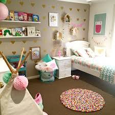 20 Whimsical Toddler Bedrooms for Little Girls the Pom Pom rug looks great  and everything has a place of its own.