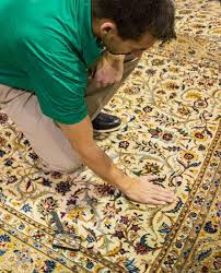 professional area and oriental rug technician by green mitten chem dry
