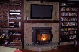 image of mounting tv above fireplace insert