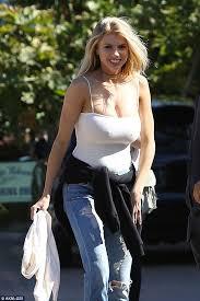 Buste girl in white top