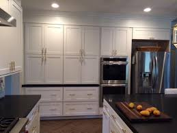 wall of stacked shaker cabinets in white what are90