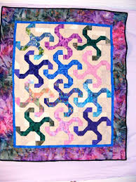 Bright batiks quilt in the Monkey Wrench pattern &  Adamdwight.com