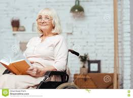 content old disabled lady reading book at home stock image image of pensioner