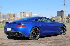 aston martin vanquish cobalt blue. 2014 aston martin vanquish rear 34 view cobalt blue