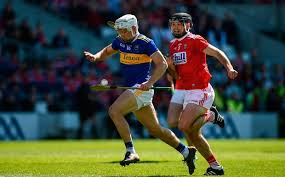 niall omeara of tipperary in action against christopher joyce of cork during the munster gaa hurling