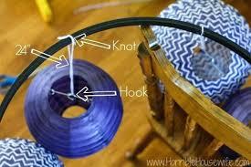 purple paper lantern chandelier tutorial step 3 cut inch pieces of yarn diy