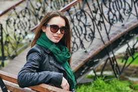 portrait of a young woman wearing sunglasses in the city the girl is wearing a