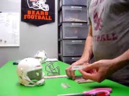 assembling a custom mini football helmet with decals stripes and