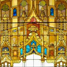 a section of a red stained glass window