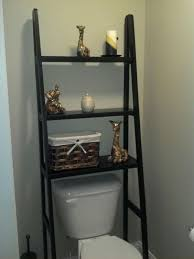 Take a ladder shelf and left out the bottom 2 rows to fit perfectly over the