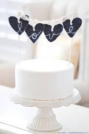 diy denim jean bleach letter love heart wedding cake topper via kara s party ideas