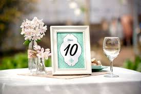 table numbers wedding. a green wedding table number in frame numbers
