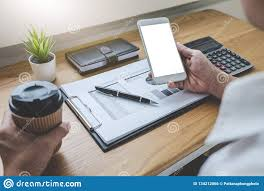 Image Costco Businessman Working On Graph Document Financial Report And Analysis Calculation Investment Cost With Calculator At Office Desk And Other Objects Around Standdesk Businessman Working On Graph Document Financial Report And