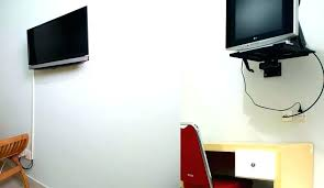 flat screen tv wall mount bracket with locking feature shelf instructions vs stand best hanging