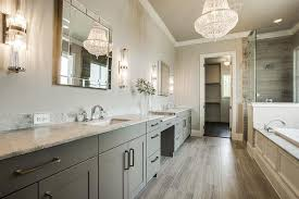 gray on gray bathroom design with white chandelier