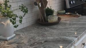 architecture gray granite countertops new fantasy brown with small white subway tiles and warm 0