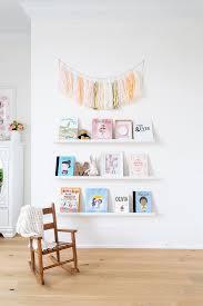 white floating bookshelves nursery