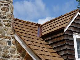 cedar roof. some property owners prolong the cedar roof lifespan of their roofs with using preservatives that are applied regularly and keep shingle appearance or