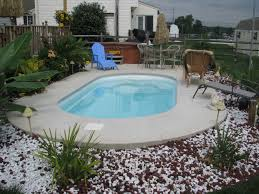 a simple small fiberglass pool perfect to just cool off in for that small backyard or small family