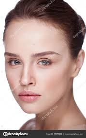young female model with soft skin and natural makeup stock image