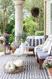 fall porch decorating with neutral accents and pale pink mums maison de pax