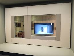 white living room furniture with a swivel tv