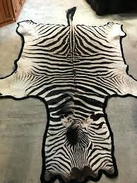 zebra hide rug image 1 uk stenciled cowhide metallic