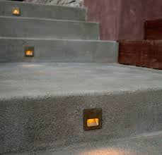 stair lighting fixtures. above single riser step lights center mounted in concrete stairs garden by remodelista architect and designer directory member pedersen associates stair lighting fixtures