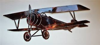 biplane metal wall art