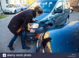 minor car accident. car accident with minor damage. to woman discus the reason of crash, who is guilty. s