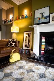 living room orla kiely multi: orla kielys lounge love the tiling on the fireplace