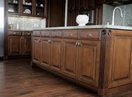 image of distressed black kitchen cabinets