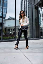 fashion blogger mia mia mine wearing black lace up faux leather pants by blank denim
