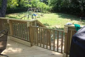 use metal slider hardware wood at bottom keeps gate in track