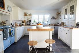 white country kitchen with butcher block. Cozy Country Kitchen With White Cabinets, Blue Vintage Stove And Butcher Block Island N
