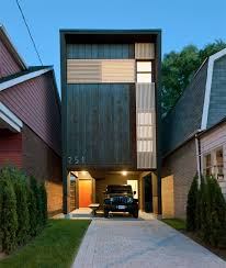 11 Small Modern House Designs // This narrow house fits tightly between the  two houses