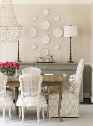 oly dining chairs. stunning dining room features a carved wood table lined with white cane back chairs skirted seat cushions as well slipper captain oly r