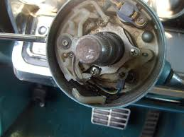 steering column shifter taking flight again getting the wheel off reveals the turn signal mechanism the canceling prong for one direction