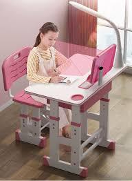 Bộ bàn ghế học sinh cho bé tiểu học (tặng kèm đèn led 3 chế độ và chống  cằm)