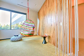 microsoft redmond office. Behind A Wall Made Of Thick, Hanging Ropes To Look Like Vines Is Microsoft Redmond Office