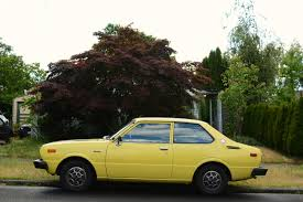 OLD PARKED CARS.: 1975 Toyota Corolla Deluxe.