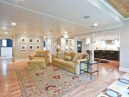 basement apartment design. White Covered Deck Ceiling Design In Fancy Large Basement Apartment Ideas With Archways