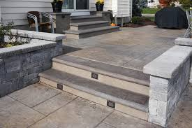 Stamped concrete patio with stairs Ashlar Stamped Roman Slate Pennsylvania Slate In Gray Tones Steps With Lighting For Both Aesthetics And Safety Finishing Edge Inc Portfolio Photo Gallery Of Beautiful Steps Finishing Edge Inc
