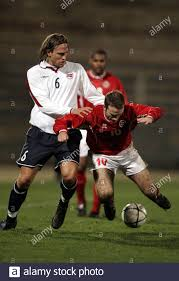 Norway's Thorstein Helstad (L) pulls down Malta's Ivan Woods (R) during a  friendly soccer match in the Ta Qali National Stadium, Valletta February 9,  2005. REUTERS/Darrin Zammit Lupi Stock Photo - Alamy