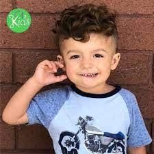 This cut would take the natural shape of his mixed curly hair and trim it up into an even baby fro. Top Kids Hairstyles 2018 Long Hairstyles For Boys Long Hair Haircuts For Boys