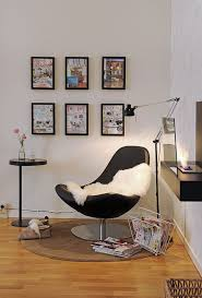 modern black chair with soft white blanket a magazine storage floating desk  in black sophisticated standing