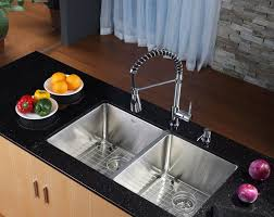 cool kitchen design using double sink and faucet with dark countertop